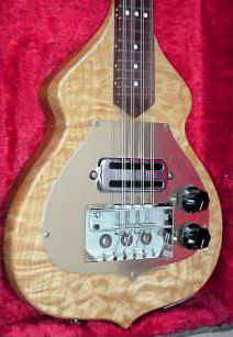 Rickenbacker solid-body electric mandolin with beautiful curly maple body (bridge cover missing in this photo)
